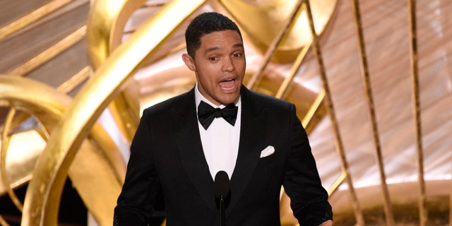 """Trevor Noah introduces """"Black Panther"""" at the Oscars on Sunday, Feb. 24, 2019, at the Dolby Theatre in Los Angeles. (Photo by Chris Pizzello/Invision/AP)"""