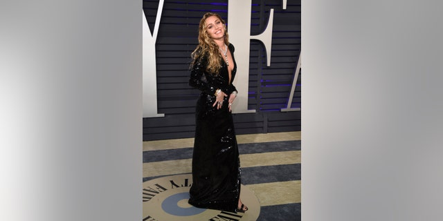 Miley Cyrus arrives at the Vanity Fair Oscar Party.