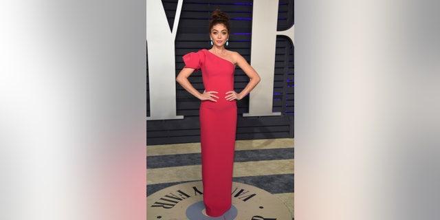 Sarah Hyland arrives at the Vanity Fair Oscar Party.