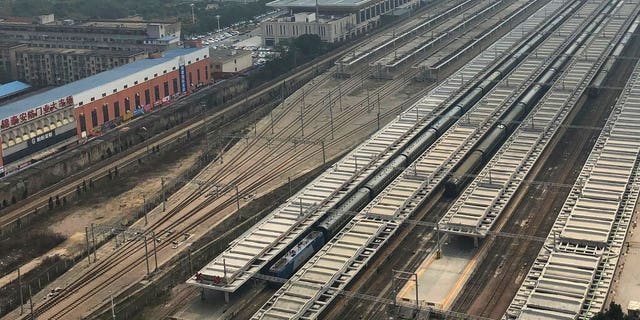 A train, center, similar to ones seen during previous visits to China by North Korean leader Kim Jong Un is seen at Changsha station in central China's Hunan province, Monday.