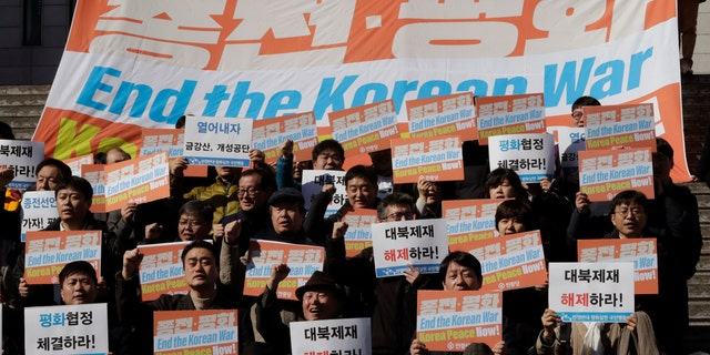 South Korean protesters shout slogans during a rally demanding the end the Korean War and to stop the sanction on North Korea near the U.S. embassy in Seoul, South Korea, Tuesday, Feb. 26, 2019. (AP Photo/Lee Jin-man)