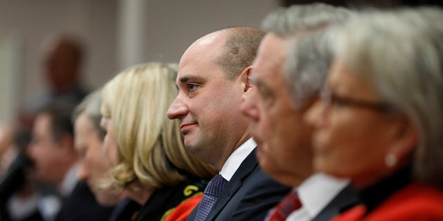 Matt Maddox, center, CEO of Wynn Resorts Ltd., attends a meeting of the Nevada Gaming Commission, Tuesday, Feb. 26, 2019, in Las Vegas.