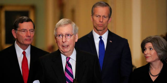 Senate Majority Leader Mitch McConnell, R-Ky., With, from left, Sens. John Barrasso, R-Wyo., McConnell, John Thune, RS.D. , and Joni Ernst, R-Iowa, speakING to reporters on Capitol Hill in Washington, Tuesday. (AP Photo / Manuel Balce Ceneta)