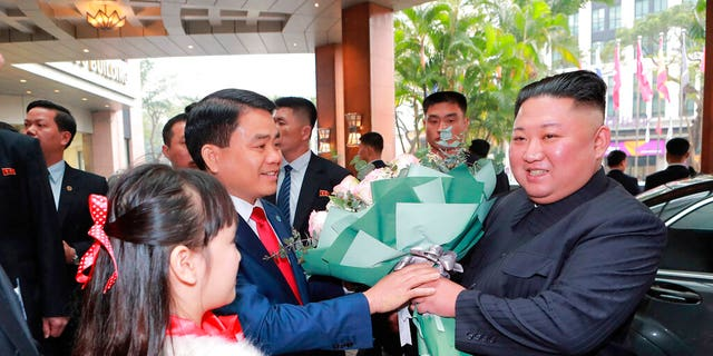 """In this Tuesday photo provided by the North Korean government, North Korean leader Kim Jong Un, right, is welcomed on his arrival at the Melia Hotel in Hanoi, Vietnam. The content of this image is as provided and cannot be independently verified. Korean language watermark on image as provided by source reads: """"KCNA"""" which is the abbreviation for Korean Central News Agency. (Korean Central News Agency/Korea News Service via AP)"""
