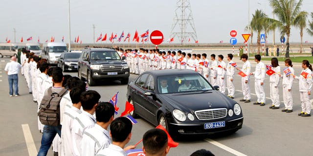 Students of Vinfast Training Centre holding flags of Vietnam and North Korea greet as the car carrying North Korean ruling party senior leader Ri Su Yong arrives at VinFast, automotive startup manufacturer in Hai Phong, Vietnam Wednesday, Feb. 27, 2019.