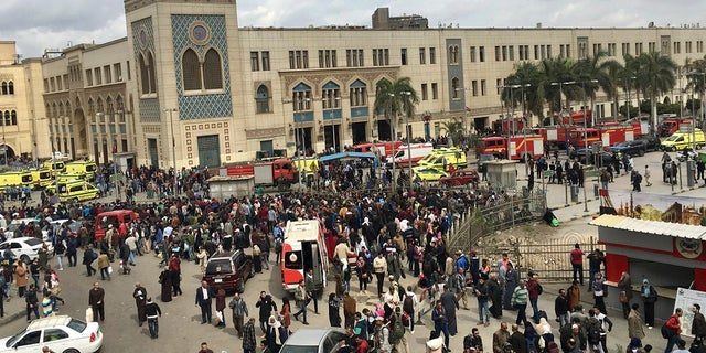 People gather outside Ramsis train station in Cairo, Egypt, Wednesday, Feb. 27, 2019. (AP Photo/Nariman El-Mofty)