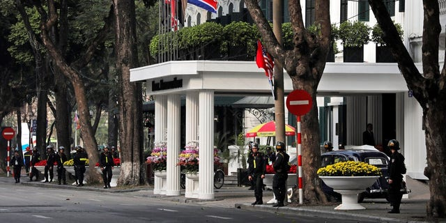 Police officers stand guard outside Metropole hotel where U.S President Donald Trump and North Korean leader Kim Jong Un are scheduled to have dinner in Hanoi, Vietnam.
