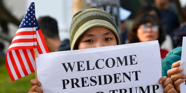 People gather near the area where U.S. President Donald Trump and North Korean leader Kim Jong Un will meet for dinner in Hanoi, Vietnam, Wednesday.