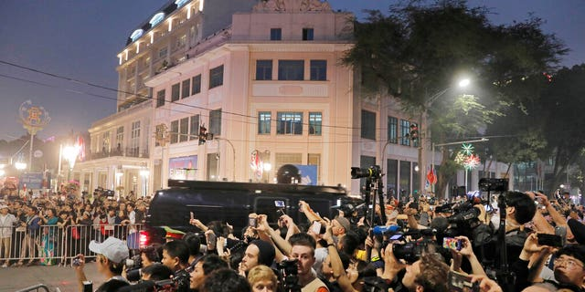 People gathered outside Metropole Hotel where U.S President Donald Trump and North Korean leader Kim Jong Un had dinner on Wednesday.