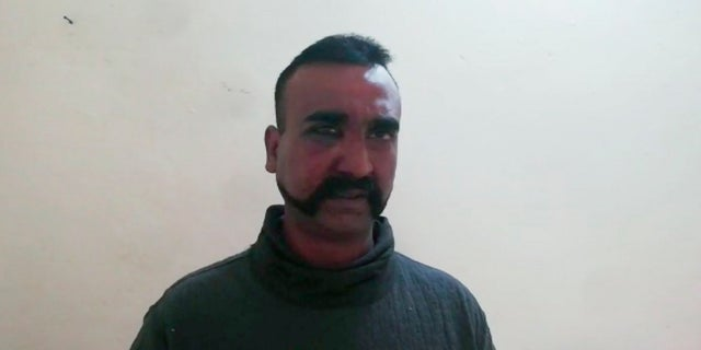 In this image taken from video released by Pakistan's military, showing what they claim to be an Indian pilot who was captured after his plane was shot down by Pakistan's Air Force in the country's part of Kashmir.