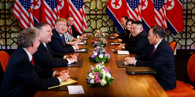 President Donald Trump speaks during a meeting with North Korean leader Kim Jong Un Thursday, Feb. 28, 2019, in Hanoi. At front right is Kim Yong Chol, a North Korean senior ruling party official and former intelligence chief. At left is national security adviser John Bolton and Secretary of State Mike Pompeo, second from left.