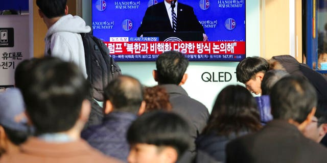 People watch a TV screen showing U.S. President Donald Trump's press conference, during a news program at the Seoul Railway Station in Seoul, South Korea, Thursday, Feb. 28, 2019.