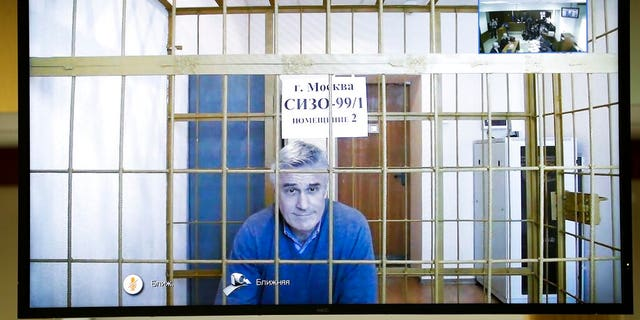 Michael Calvey is seen on a screen during a court session in a courtroom in Moscow, Russia, Thursday, Feb. 28. A Moscow court on Thursday, rejected an appeal by one of Russia's best-known foreign investment managers, ordering to keep Calvey in jail for at least the next month and a half.
