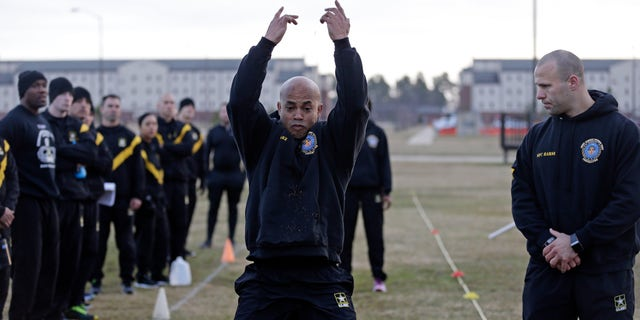 In this Jan. 8, 2019, photo, U.S Army troops watch as instructors demonstrate aspects of the new Army combat fitness test at the 108th Air Defense Artillery Brigade compound at Fort Bragg, N.C.