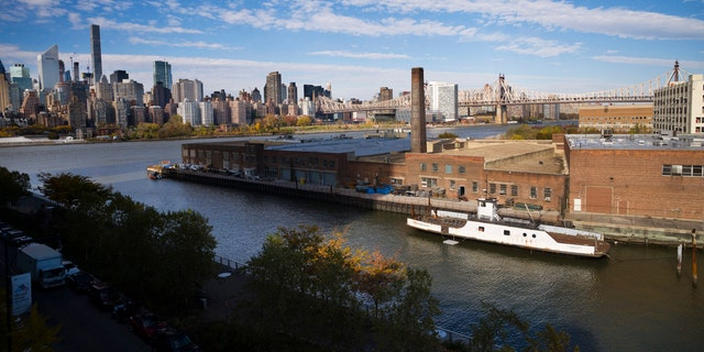 A rusting ferryboat is docked next to an aging industrial warehouse on Long Island City's Anable Basin in the Queens borough of New York. The shockwaves from Amazon's decision not to build its HQ2 in Queens look set to reverberate.