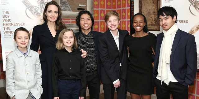 """Angelina Jolie with children Knox Leon Jolie-Pitt, Vivienne Marcheline Jolie-Pitt, Pax Thien Jolie-Pitt, Shiloh Nouvel Jolie-Pitt, Zahara Marley Jolie-Pitt and Maddox Chivan Jolie-Pitt. They attended a screening of """"The Boy Who Harnessed The Wind"""" in New York in February. (Photo by Monica Schipper/Getty Images for Netflix)"""