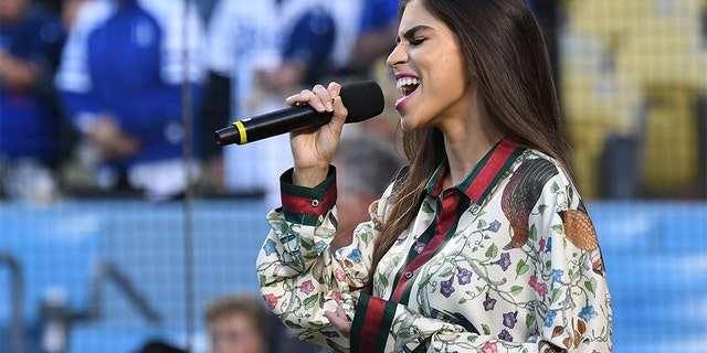 Antonella Barba sings the National Anthem before the game between the Los Angeles Dodgers and the Arizona Diamondbacks at Dodger Stadium on April 14, 2017 in Los Angeles, Calif.