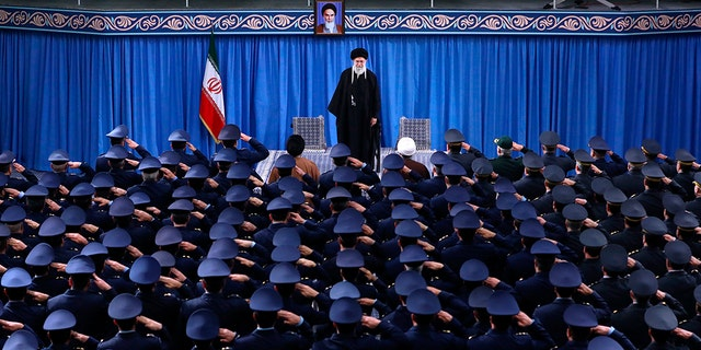 """In this picture released by an official website of the office of the Iranian supreme leader, Supreme Leader Ayatollah Ali Khamenei stands as army air force staff salute at the start of their meeting in Tehran, Iran, Friday, Feb. 8, 2019. Khamenei is defending """"Death to America"""" chants that are standard fare at anti-U.S. rallies across Iran but says the chanting is aimed at America's leaders and not its people. (Office of the Iranian Supreme Leader via AP)"""