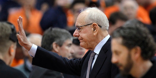 Syracuse coach Jim Boeheim waves before the team's NCAA college basketball game against Duke in Syracuse, N.Y., Saturday, Feb. 23, 2019.