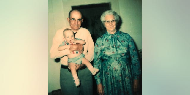 An early picture of Brandon with his maternal grandparents.