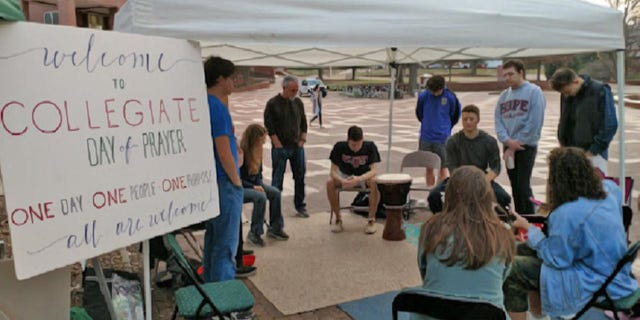 """The Collegiate Day of Prayer tent at North Carolina State. The day of prayer is expected to bring hundreds of thousands of college students and community members together praying for a """"student awakening"""" on campuses across the nation."""