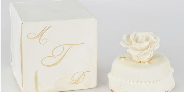 "The 14-year-old sweet for sale comes packaged in its original ivory box, stamped with a gold monogram ""MDT."""