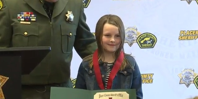 Isabell Pierce was presented with a Citizen's Medal of Merit for her heroism during the shooting spree on Jan. 15.