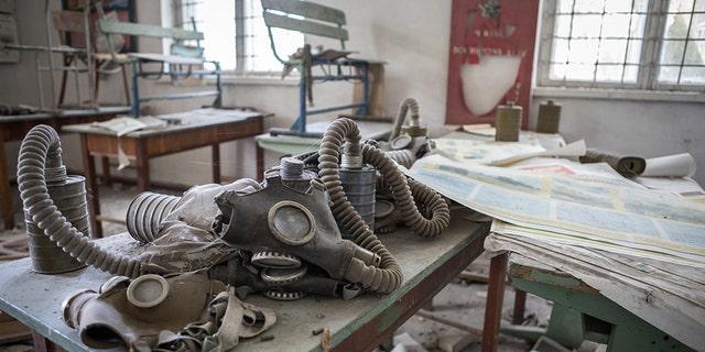 Gas masks left on a school desk. (Credit: Media Drum World)