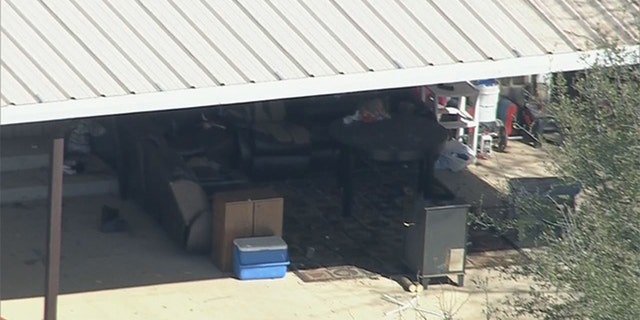 Part of the property where deputies found two young, malnourished children locked together in a dog cage near Rhome, Texas about 20 miles northwest of Fort Worth.