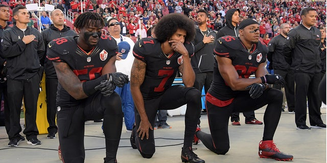 San Francisco 49ers outside linebacker Eli Harold (58), quarterback Colin Kaepernick (7) and free safety Eric Reid (35) kneel in protest during the playing of the national anthem before an NFL game against the Arizona Cardinals at Levi's Stadium in 2016. (Kirby Lee-USA TODAY Sports)