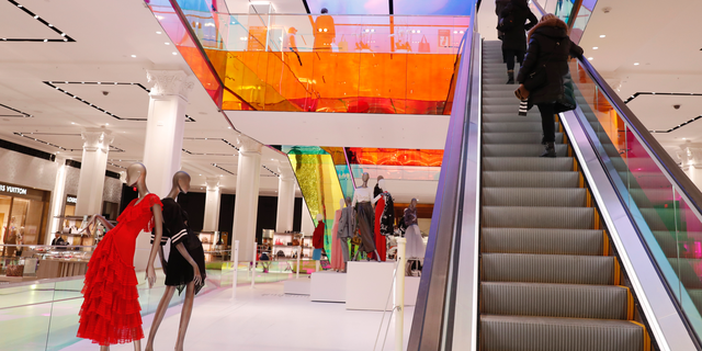 FILE- In this Wednesday, Feb. 20, 2019, file photo shoppers ride the escalator at Saks Fifth Avenue's flagship midtown Manhattan store, in New York. On Tuesday, Feb. 26, the Conference Board releases its February index on U.S. consumer confidence. (AP Photo/Kathy Willens, File)