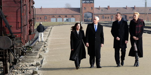 United States Vice President Mike Pence and his wife Karen Pence, left, walk with Poland's President Andrzej Duda and his wife Agata Kornhauser-Duda, right, during their visit at the Nazi concentration camp Auschwitz-Birkenau.