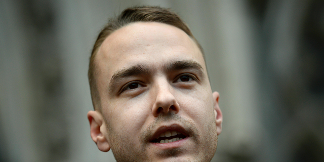 David Challen, son of Georgina Challen, known as Sally, speaks outside the High Court in London, Thursday, Feb. 28, 2019. A British court has overturned the conviction of a woman serving a life sentence for murder for killing her husband. Sally Challen was convicted in 2011 of killing her husband Richard with a hammer. Three Court of Appeal judges have ordered a retrial, saying Challen was suffering from two mental disorders at the time of the killing. (Kirsty O'Connor/PA via AP)