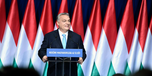 """Hungarian Prime Minister Viktor Orban delivers his annual """"State of Hungary"""" speech in Budapest, Hungary, Sunday, Feb. 10, 2019. The inscription reads: """"For us Hungary is the first!"""""""