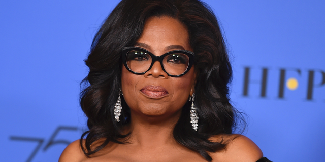 "FILE - In this Jan. 7, 2018 file photo, Oprah Winfrey poses in the press room with the Cecil B. DeMille Award at the 75th annual Golden Globe Awards in Beverly Hills, Calif. Winfrey will interview two men who say Michael Jackson sexually abused them as boys immediately after a documentary on the men. HBO and the Oprah Winfrey Network announced Wednesday that ""After Neverland,"" will air on both channels Monday at 10 p.m. Eastern and Pacific. (Photo by Jordan Strauss/Invision/AP, File)"