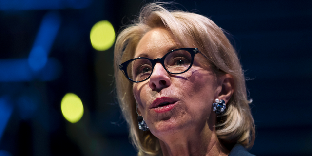 FILE - In this Sept. 17, 2018 file photo, Education Secretary Betsy DeVos speaks during a student town hall at National Constitution Center in Philadelphia. Democrats in Congress are accusing the Education Department of interfering with an investigation by the agency's independent watchdog. Five lawmakers sent a letter to DeVos on Feb. 19, 2019, staying her deputy pressured the department's inspector general on Jan. 3 to drop an internal investigation. (AP Photo/Matt Rourke, File)