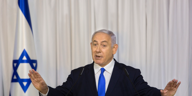 FILE - In this Thursday, Feb. 21, 2019 file photo, Israeli Prime Minister Benjamin Netanyahu delivers a statement in Ramat Gan, Israel. The attorney general's decision on whether to indict Netanyahu on a series of corruption allegations is expected to be delivered Thursday, Feb. 28, 2019. Avichai Mandelblit is expected to announce his decision after more than two years of intense investigations and deliberations. (AP Photo/Sebastian Scheiner, File)