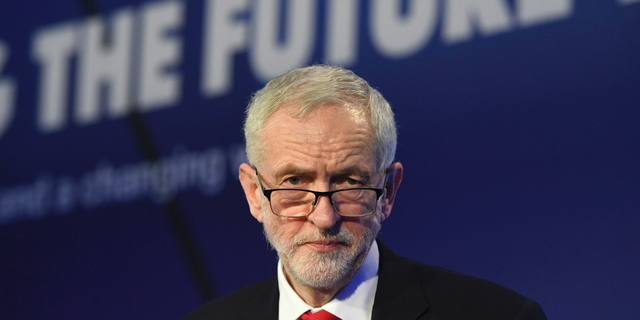 Britain's main opposition Labour Party leader Jeremy Corbyn speaks during the annual conference of the EEF manufacturers organisation at the Queen Elizabeth II Conference Centre in London, Tuesday Feb. 19, 2019.  Seven British lawmakers quit the Labour Party on Monday over its approach to Brexit and alleged anti-Semitism, the biggest shake-up in years for one of Britain's major political parties. (Stefan Rousseau/PA via AP)