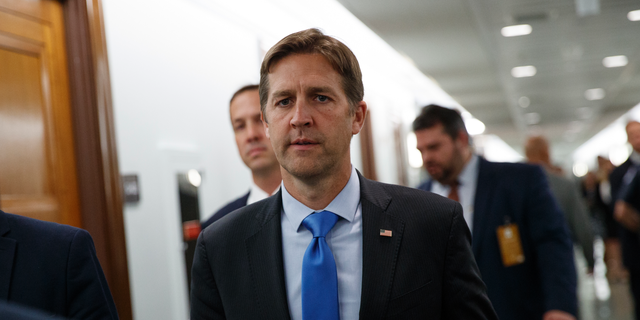In this Sept. 27, 2018, file photo, Sen. Ben Sasse, R-Neb., walks on Capitol Hill in Washington. Sasse Sunday said he supported the U.K.'s move to freeze Huawei out of its 5G network. (AP Photo/Carolyn Kaster)