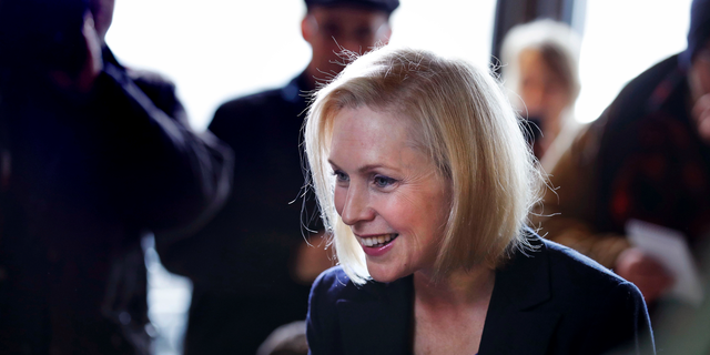 Sen. Kirsten Gillibrand, D-NY, smiles as she listens to a patron while visiting a coffee shop on Main Street in Concord, N.H., Friday, Feb. 15, 2019. Gillibrand visited New Hampshire as she explores a 2020 run for president. (AP Photo/Charles Krupa)