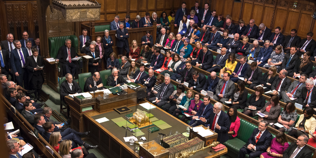Britain's main opposition Labour Party leader Jeremy Corbyn, centre right, stands to talk to lawmakers inside  parliament, London, Wednesday Feb. 27, 2019.  Prime Minister Theresa May insisted Wednesday that Britain will leave the European Union on schedule next month, amid signs that her promise to give Parliament a vote on delaying Brexit was boosting support for her unpopular EU divorce deal. (Mark Duffy/UK Parliament via AP)