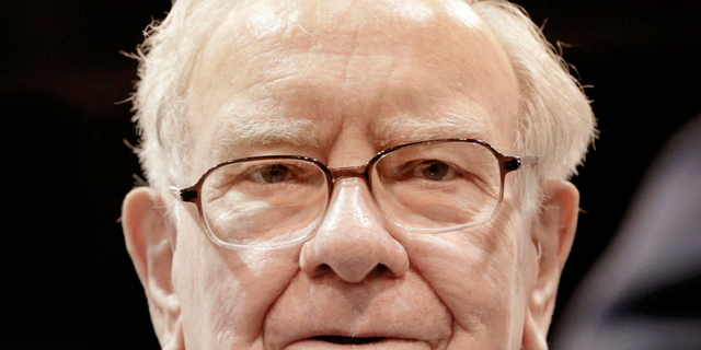 FILE - In this May 5, 2018 file photo, Warren Buffett, Chairman and CEO of Berkshire Hathaway, is seen during a tour of the exhibit floor at the CenturyLink Center in Omaha, Neb. Buffett will release his annual letter to Berkshire Hathaway shareholders on Saturday, Feb. 23, 2019. Buffett's letters are always one of the best-read business documents every year.  (AP Photo/Nati Harnik)
