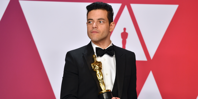 "Rami Malek, winner of the award for best performance by an actor in a leading role for ""Bohemian Rhapsody"", poses in the press room at the Oscars on Sunday, Feb. 24, 2019, at the Dolby Theatre in Los Angeles."