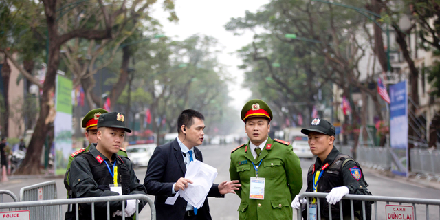 Security guards stand at a barricaded outside Melia Hotel where North Korean leader Kim Jong Un was expected to stay, in Hanoi, Vietnam, Tuesday, Feb. 26, 2019. Kim arrived in Vietnam Tuesday for his second summit with U.S. President Donald Trump. (AP Photo/Gemunu Amarasinghe)
