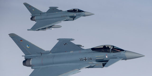 File -- In this Tuesday, April 25, 2017 photo German Eurofighter Typhoon fighter jets participate in NATO's Baltic Air Policing Mission operate in Lithuanian airspace during an air force exercise. Britain's top diplomat is demanding that Germany relax its ban on arms sales to Saudi Arabia because they are affecting UK sales of weapons to the oil-rich kingdom. (AP Photo/Mindaugas Kulbis, file)