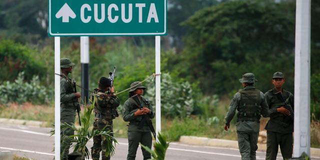 Venezuelan Bolivarian Army soldiers stand guard at the Tienditas International Bridge that links Colombia and Venezuela, near Urena, Venezuela, Friday, Feb. 8, 2019. (AP Photo/Fernando Llano)