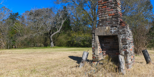 This chimney in Africatown, Mobile, Ala., is the last remaining original structure from the days when survivors of the Clotilda inhabited the area. (AP Photo/Julie Bennett)