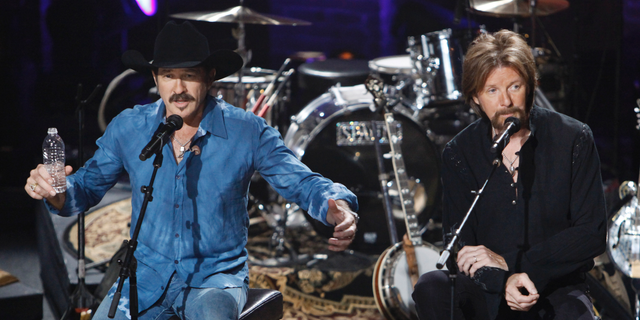 In this Aug. 12, 2009, file photo, Kix Brooks, left, and Ronnie Dunn of the country music duo Brooks & Dunn talk about their decision to stop performing together as they answer questions from the audience during a television taping in Nashville, Tenn. (AP Photo/Mark Humphrey)