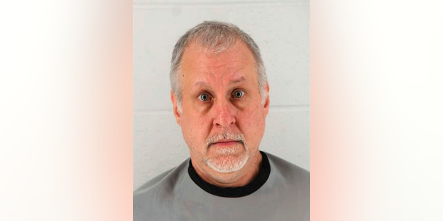 This Jan 24, 2019 booking photo released by Johnson County Sheriff's Office shows Raymond McManness. Court records say the suburban Kansas City man told investigators he didn't seek medical care for his ailing mother before she died weighing just 58 pounds and suffering from open bed sores. The Kansas City Star reports that the records were released Wednesday, Feb. 20, 2019, in the case against 51-year-old McManness, of Olathe, Kan. (Johnson County Sheriff's Office via AP)