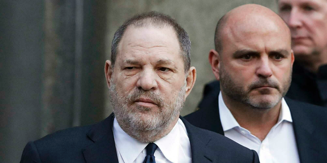 In this Thursday, Dec. 20, 2018, file photo, Harvey Weinstein, center, leaves New York Supreme Court in New York. Weinstein's sexual assault trial in New York City is being delayed until June 3, 2019. (AP Photo/Mark Lennihan, File)